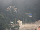 The hills around ... the yellow Budhist temple seen from my balcony on foggy morinings